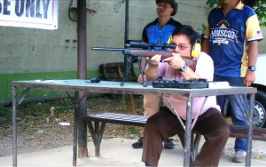 Doc Sure Shot: Orthopaedic surgeon Dr. Ticman, seen here testing the new Armscor TCM rifle, believes that outdoors men and women should be especially conscious about proper bone care. (Photo by IGG)