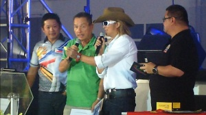 Free guns! Joe Dionisio announces the winner of one of the eight pistols that were raffled off during the event. His son, AFAD president and shooting icon Jethro looks on. (Photo by IGG)