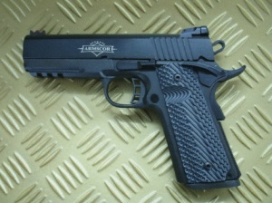 """Compact with rail: This """"Commander"""" length 1911 has all the upgrades one could ever need. It sports a pair of elegant VZ Grips."""