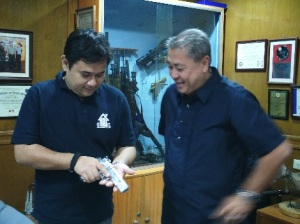 Aggressive marketing: Armscor COO George Chua shows the author a pistol that is representative of the firm's expanded line.